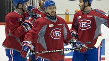 Montreal Canadiens centre Tomas Plekanec, front, waits to shoot as teammates Raphael Diaz, left, Josh Gorges and Brandon Prust, right, look on during the team's practice Monday, April 29, 2013 in Brossard, Que. (Ryan Remiorz/THE CANADIAN PRESS)