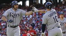 Tampa Bay Rays catcher Kelly Shoppach (10) congratulates designated hitter Johnny Damon (22) on his two-run home run against the Texas Rangers during the second inning of Game 1 of the American League division series playoffs Friday, Sept. 30, 2011, in Arlington, Texas. (Tony Gutierrez/AP)