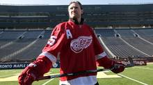 Detroit Red Wings player Niklas Kronwall stands on the field at Michigan Stadium in Ann Arbor, Michigan February 9, 2012, following an announcement that the Red Wings will host the Toronto Maple Leafs at Michigan Stadium on the University of Michigan campus in the 2013 Bridgestone NHL Winter Classic. REUTERS/Rebecca Cook (Rebecca Cook/Reuters)