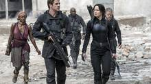 Liam Hemsworth and Jennifer Lawrence star in The Hunger Games: Mockingjay – Part 1, in which the trilogy gets very bleak. (Murray Close)