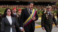 On April 12, Venezuela's creditors reaped large returns when President Nicolas Maduro, centre, made good on $2.5-billion (U.S.) in debt payments even as he struggles to come up with enough money for food imports. (HANDOUT/REUTERS)