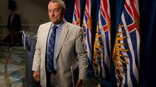 B.C. Education Minister Peter Fassbender leaves after speaking about the teachers' strike and confirming classes at public school will not begin Tuesday, during a news conference in Vancouver, B.C., on Sunday August 31, 2014. (DARRYL DYCK/THE CANADIAN PRESS)