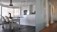 Toronto condo at Avenue and Bloor renovated by architect Dimitri Papatheodoro. The suite in an older building offered a generous amount of space and a sunset view overlooking the Royal Ontario Museum and the University of Toronto.