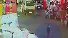 In this image taken from Oct. 13, 2011 security camera video run by China's TVS, a 2-year-old girl, identified as Wang Yue, is seen just before she is hit by a white van seen in the background in Foshan in southern China's Guangdong province. (TVS via APTN/AP)