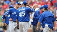 Blue Jays players and staff cluster around pitcher Francisco Liriano after he was hit by line drive in Arlington, Tex., Friday. (Kevin Jairaj/USA Today Sports)