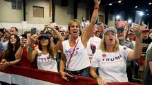 Supporters of Republican presidential candidate Donald Trump cheer during a campaign rally at the South Florida Fairgrounds and Convention Center, Thursday, Oct. 13, 2016, in West Palm Beach, Fla. (AP Photo/ Evan Vucci)