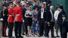 People wait to enter Westminster Abbey prior to the Royal Wedding in London Friday, April, 29, 2011. (Gero Breloer/Gero Breloer/AP)
