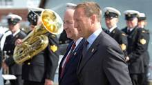 Defence Peter MacKay arrives at a naval ceremon in Halifax with Justice Minister Rob Nicholson on Aug. 16, 2011. (SANDOR FIZLI/REUTERS)