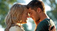 "Taylor Schilling and Zac Efron in a scene from ""The Lucky One"" (Alan Markfield/AP/Warner Bros.)"