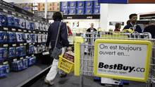 Shoppers visit a Best Buy in Montreal. A judge has ruled that major retailers do not have to modify their commercial names to French to continue operating in Quebec. (CHRISTINNE MUSCHI/THE GLOBE AND MAIL)