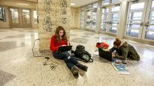 Kate Dermo, left, and Layla Crowe study in the entrance of Hamilton's Westmount Secondary School. (Glenn Lowson For the Globe and Mail)