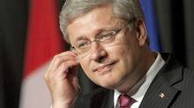 Prime Minister Stephen Harper listens to a question during a joint news conference with his Honduran counterpart in San Pedro Sula on Aug. 12, 2011. (Adrian Wyld/THE CANADIAN PRESS)