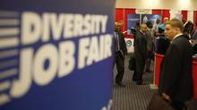 Attendees carry their resumes as they arrive at a job fair in a Washington hote in this file photo. (JASON REED/REUTERS)
