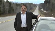 Prince George City Councillor, Brian Skakun with his car on a long strech of Highway 16 East near Prince George as a fuel transport truck passses by. (Dave Milne for The Globe and Mail/Dave Milne for The Globe and Mail)