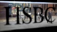 An HSBC sign near Bay Street, Toronto. Parent HSBC Holdings PLC is selling non-core assets in a bid to cut $3.5-billion in costs. Brent Lewin/Bloomberg News (Brent Lewin/Bloomberg News)
