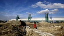 Archeologists dig into the Canadian National Exhibition parking lot in front of the Direct Energy Centre in mid-November. The team is excavating the foundations of the 1840s enlisted men's barracks. (Michelle Siu for The Globe and Mail)