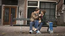 Hazel (Shailene Woodley) and Gus (Ansel Elgort) share a tender moment during a memorable trip to Amsterdam. (James Bridges/Twentieth Century Fox Film Corporation)
