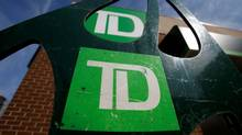 Toronto-Dominion Bank (TD) logos are seen outside of a branch in Ottawa. (© Chris Wattie / Reuters)