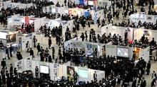 University students take part in a job fair in Tokyo. Graduates around the world are facing a tough job market. (Tomohiro Ohsumi/Bloomberg)