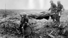 Canadians wounded in the savage First World War fighting at Passchendaele in Flanders are evacuated by stretcher bearers. (CP)
