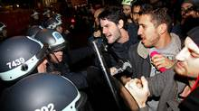 Occupy Wall Street protesters clash with police at Zuccotti Park after being ordered to leave their longtime encampment in New York, early Tuesday, Nov. 15, 2011. (Craig Ruttle/AP/Craig Ruttle/AP)
