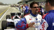 Michael Andretti (left) discusses his car's performance with a crew member in the pits at the Indianapolis Motor Speedway back in 2001. (Robin Jerstad/REUTERS)