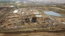 This 2014 file photo shows a construction site at the Suncor Fort Hills oil sands mining operations near Fort McMurray, Alberta. (Todd Korol / Reuters)