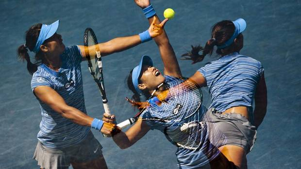 Li Na of China serves to Sorana Cirstea of Romania during their women's semi-finals tennis match of the Rogers Cup tennis tournament in Toronto August 10, 2013. The image is an in-camera, multiple exposure photograph. (MARK BLINCH/REUTERS)