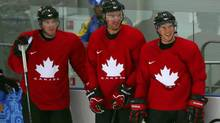 Canada's, from left, Matt Duchene, Jeff Carter and Sidney Crosby look on during their men's team ice hockey practice at the 2014 Sochi Winter Olympics, February 12, 2014.  (Reuters)
