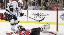 Los Angeles Kings' Anze Kopitar, of Slovenia, scores past New Jersey Devils' Martin Brodeur during overtime in Game 1 of the NHL hockey Stanley Cup finals Wednesday, May 30, 2012, in Newark, N.J. (Associated Press)