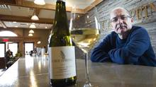 Angelo Pavan of Cave Spring shows off a glass of the winery's chardonnay musqué. (Kevin Van Paassen/The Globe and Mail)