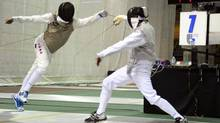 Mark Ballard, wearing blue shoes, in action at a fencing tournament in Montreal in January, 2012. (HEATHER MACLAREN)