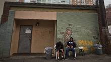 Patrons of a temporary homeless shelter run by HEAT situated in a residential neighborhood sit outside the shelter onJune 12, 2009. (JOHN LEHMANN/ THE GLOBE AND MAIL/JOHN LEHMANN/ THE GLOBE AND MAIL)