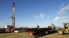 Drilling pipe is unloaded for a drilling rig near near Golden Prairie, Sask. (Larry MacDougal)