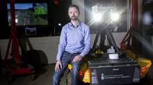 Professor Tim Barfoot is pictured in his lab at University of Toronto's Institute for Aerospace Studies with a Grizzly robotic utility vehicle on April 11, 2017. (Chris Young/THE CANADIAN PRESS)