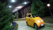 """The Commuter Cars Tango electric car is taken for a test drive on the """"The EcoXperience"""" indoor test drive track at the 2010 North American International Auto Show. Mark Blinch/Reuters (MARK BLINCH/MARK BLINCH/REUTERS)"""