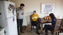 From left, roommates Ellison Richmond, Nina Martensson and Brianne Miller share breakfast in their Vancouver suite last week. (Rafal Gerszak/The Globe and Mail)