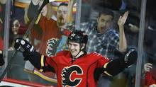 Calgary Flames' Mikael Backlund, from Sweden, celebrates his goal during third period NHL action against the Minnesota Wild in Calgary, Alberta, Saturday, Feb. 1, 2014. Backlund also scored the game winning goal allowing the Calgary Flames to beat the Minnesota Wild 4-3 in overtime. (Jeff McIntosh/AP)