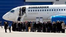 Shareholders line up to view Bombardier's CS300 aircraft following their annual general meeting in Mirabel, Que., on April 29, 2016. (Christinne Muschi/Reuters)
