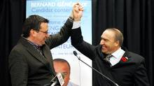 Conservative party candidate Bernard Genereux, right, celebrates with Conservative MP Christian Paradis after winning the federal by-election in the riding of Montmagny-L'Islet-Kamouraska-Riviere-du-Loup, at his headquarters of La Pocatiere Nov. 9, 2009. (MATHIEU BELANGER/Mathieu Belanger/Reuters)