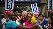 Toronto Mayor Rob Ford poses with members of the public as he takes part in the East York Canada Day Parade in his first public appearance since returning from a rehabilitation clinic for substance abuse problems in Toronto July 1, 2014. (Mark Blinch/REUTERS)