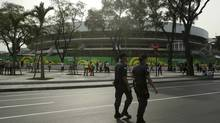 Police officers patrol near the Maracana stadium before a Confederations Cup soccer match in Rio de Janeiro on June 20, 2013. (PILAR OLIVARES/REUTERS)