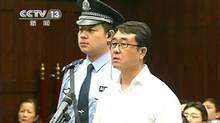 Chongqing municipality ex-police chief Wang Lijun is seen during his sentencing inside the courtroom of the Chengdu People's Intermediate Court in Chengdu, Sichuan province, China, in this still image taken from video Sept. 24, 2012. (CCTV via REUTERS TV/Reuters)