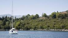 In this picture, taken on August of 2007, a partial view of Skorpios island - purchased for $20,000 by the late Artistotle Onassis in 1963. (Vasiliki Varvaki/iStockphoto)