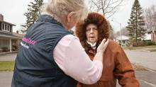 Nada Deluca, a nurse with private health care provider Nurse Next Door, walks with her patient Joan Mosdell, who suffers from dementia, outside her Mississauga home on April 10, 2011. (JENNIFER ROBERTS For The Globe and Mail)