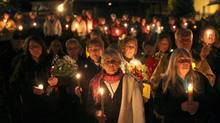 Hundreds of people gather for a candlelight vigil for the three slain murdered women September 25, 2015 in Wilno, Ontario. (Dave Chan/The Globe and Mail)