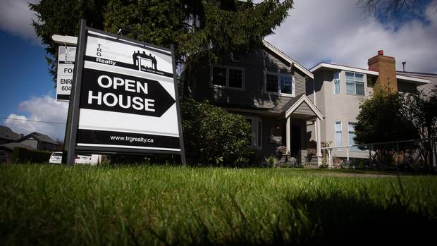 An open house sign is seen in front of a home listed for sale for $1.725-million in the neighbourhood of Arbutus, in Vancouver, B.C., on Saturday April 25, 2015.