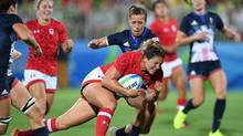 Canada's Kelly Russell runs in for a try as Great Britain's Katy McLean attempts to tackle her during the bronze medal match in women's rugby sevens at the 2016 Olympic Summer Games in Rio de Janeiro, Brazil on Monday, Aug. 8, 2016. (Sean Kilpatrick/THE CANADIAN PRESS)