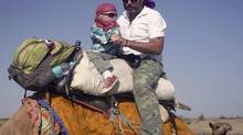 The author Graeme McRanor and his son London in the Thar Desert. (Suzanne Patrick)