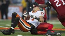 B.C. Lions slot back Nick Moore has his helmet knocked off during the Lions 37-29 loss to the Hamilton Tiger-Cats in CFL action in Guelph, Ontario September 7, 2013. (GEOFF ROBINS/REUTERS)